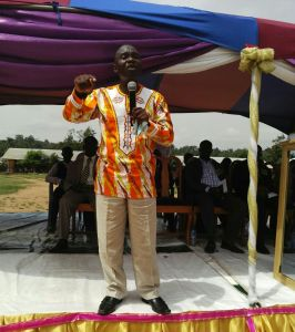 Pastor Alex AbbanQuarshie preaching at a camp meeting.